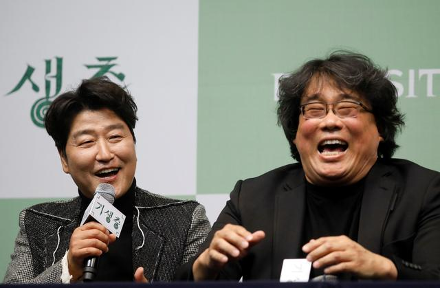 FILE PHOTO: Actor Song Kang-ho of four Oscar award-winning film 'Parasite' answers a reporters' question as Director Bong Joon-ho reacts during a news conference in Seoul, South Korea, February 19, 2020.  REUTERS/Kim Hong-Ji