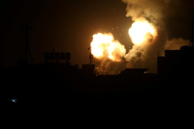 Flame and smoke are seen during Israeli air strikes in the southern Gaza Strip February 23, 2020. REUTERS/Ibraheem Abu Mustafa     TPX IMAGES OF THE DAY
