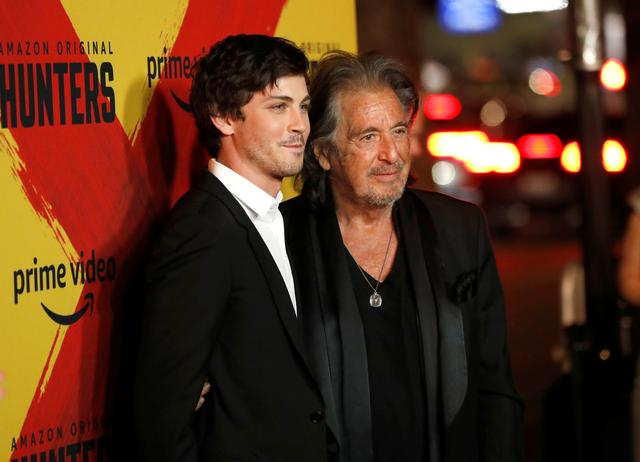 """FILE PHOTO: Cast members Al Pacino and Logan Lerman pose at a premiere for the television series """"Hunters"""" in Los Angeles, California, U.S., February 19, 2020. REUTERS/Mario Anzuoni"""