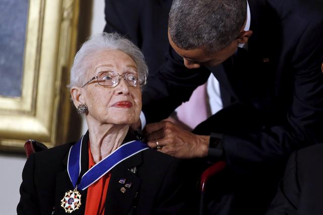 FILE PHOTO: U.S. President Barack Obama presents the Presidential Medal of Freedom to NASA mathematician Katherine G. Johnson during an event in the East Room of the White House in Washington November 24, 2015. Johnson is a pioneer in American space history. REUTERS/Carlos Barria/File Photo