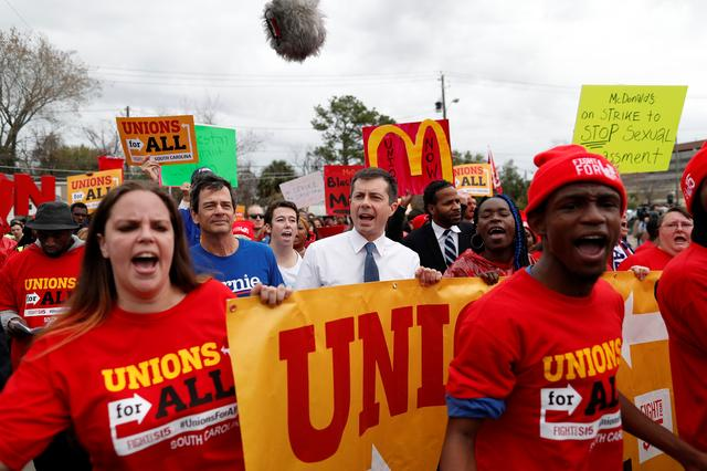 Democratic U.S. presidential candidate and former South Bend Mayor Pete Buttigieg marches with striking McDonald's workers while campaigning in Charleston, South Carolina, U.S., February 24, 2020.  REUTERS/Randall Hill