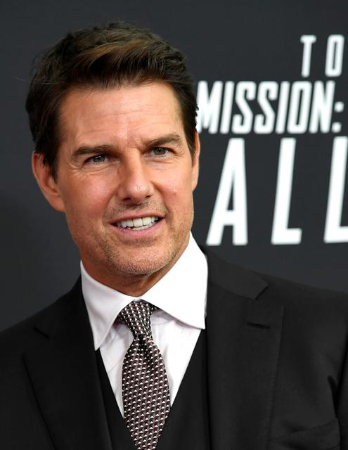 FILE PHOTO: Actor Tom Cruise poses for photographers as he arrives on the red carpet for the premiere of Mission:Impossible-Fallout, at the Smithsonian's National Air and Space Museum, in Washington, U.S., July 22, 2018.        REUTERS/Mike Theiler/File Photo