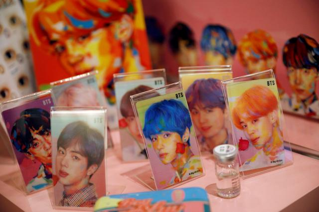 Goods of K-pop idol boy band BTS are seen on display at a pop-up store selling BTS merchandise in Seoul, South Korea, December 24, 2019.     REUTERS/Kim Hong-Ji