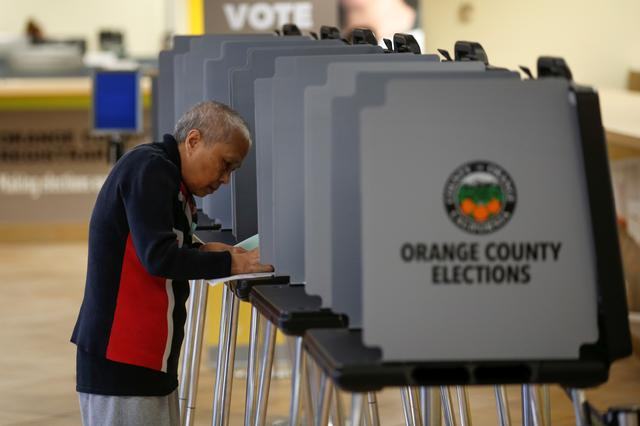 A voters cast their ballots in the March 3 Super Tuesday primary as new voting procedures and technology are used to make voting easier and more secure in Santa Ana, California, U.S., February 24, 2020. Picture taken February 24, 2020.      REUTERS/Mike Blake