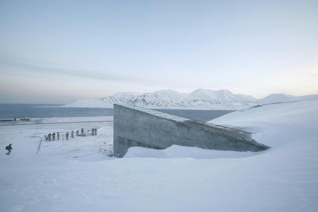 FILE PHOTO: Television crews stand outside the Global Seed Vault before the opening ceremony in Longyearbyen in the Arctic, February 26, 2008. REUTERS/Bob Strong/File Photo