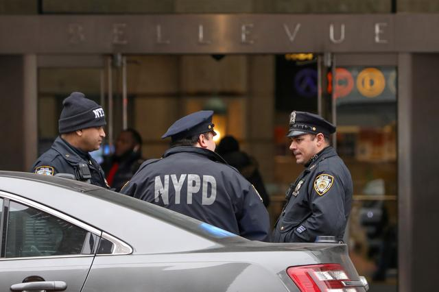 New York police officers stand outside Bellevue Hospital Center where film producer Harvey Weinstein is allegedly being held in Manhattan, February 25, 2020. REUTERS/Andrew Kelly