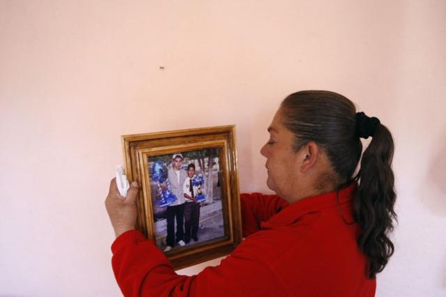 Maria Guadalupe Guereca, mother of the late Sergio Hernandez, holds a picture of her son at their home in Ciudad Juarez January 18, 2011.  Hernandez' parents have filed a lawsuit in El Paso, demanding $25 million in compensation from the U.S. government for the fatal shooting of Hernandez along a border crossing near El Paso by a U.S. border patrol agent in June 2010, according to local media. REUTERS/Gael Gonzalez