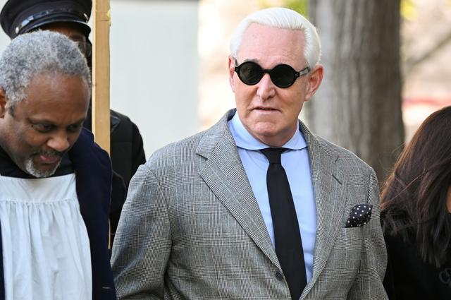 FILE PHOTO: Former Trump campaign adviser Roger Stone, joined by other witnesses, arrives for his criminal trial on charges of lying to Congress, obstructing official proceeding and witness tampering at the U.S. District court in Washington, U.S. November 14, 2019. REUTERS/Erin Scott/File Photo