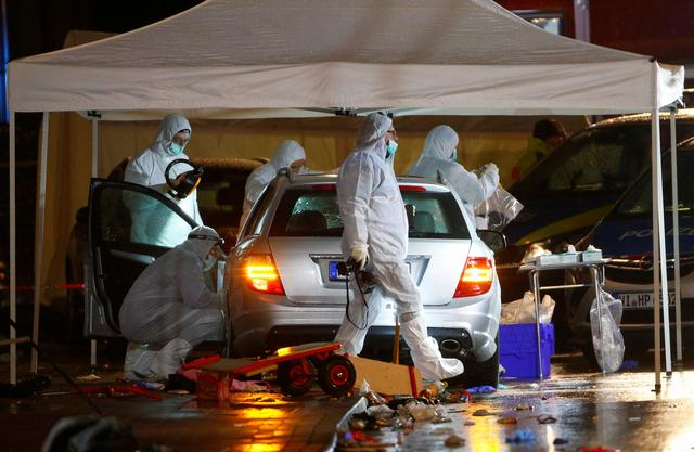 Police forensic officers work at the scene after a car ploughed into a carnival parade injuring several people in Volkmarsen, Germany February 24, 2020. REUTERS/Thilo Schmuelgen