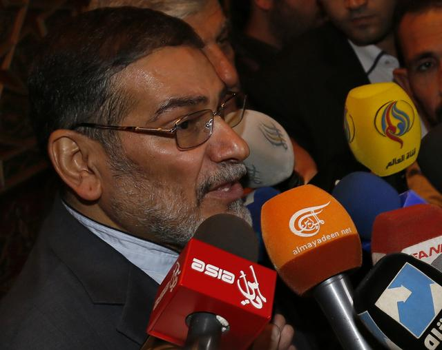 Admiral Ali Shamkhani, Iran?s Supreme National Security Council Director, speaks to the media after his arrival at Damascus airport, September 30, 2014. REUTERS/Khaled al-Hariri