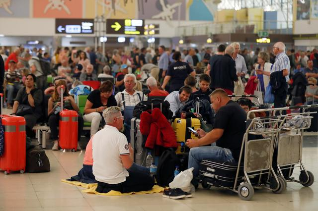 Stranded passengers wait at Las Palmas Airport in Gran Canaria, as a sandstorm locally known as ?calima? closed air traffic in the Canary Islands, February 23, 2020. REUTERS/Borja Suarez