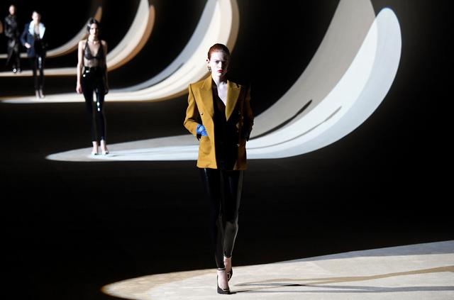 A model presents a creation by designer Anthony Vaccarello as part of his Fall/Winter 2020/21 women's ready-to-wear collection show for fashion house Saint Laurent during Paris Fashion Week in Paris, France, February 25, 2020. REUTERS/Piroschka van de Wouw