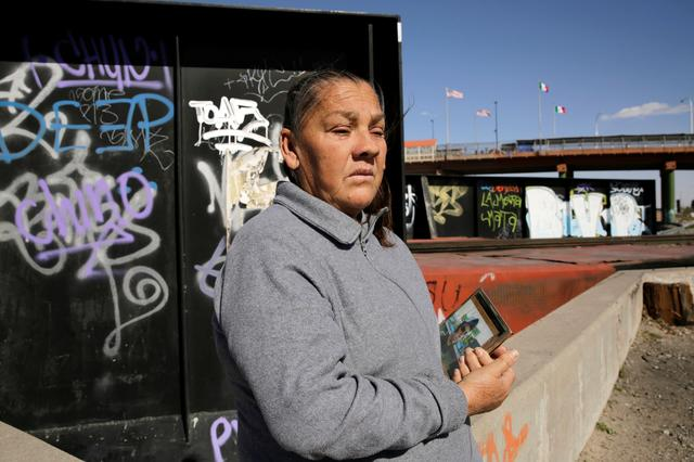 Maria Guadalupe sits near the border fence between Mexico and the U.S, where her son Sergio Adrian Hernandez was shot by a Border Patrol agent in 2010 on Mexican soil, after an interview with Reuters in Ciudad Juarez, Mexico February 25, 2020. REUTERS/Jose Luis Gonzalez