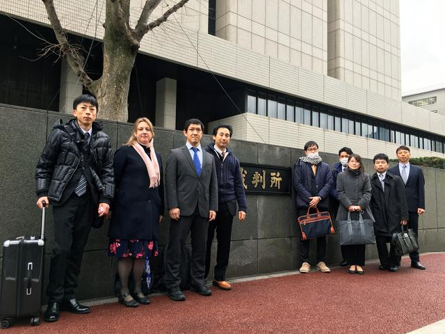 Parents estranged from their children - plaintiffs in a class-action lawsuit against the Japanese government - pose in front of the Tokyo District Court, Japan February 26, 2020. REUTERS/Chang-Ran Kim