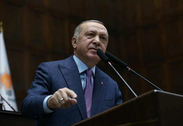 FILE PHOTO: Turkish President Tayyip Erdogan addresses members of his ruling AK Party during a meeting at the Parliament in Ankara, Turkey, February 19, 2020. Turkish Presidential Press Office/Handout via REUTERS