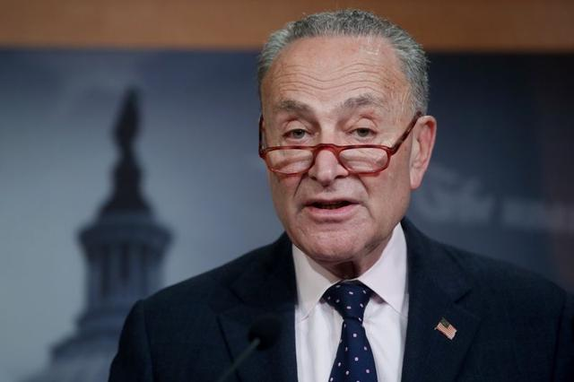 FILE PHOTO: U.S. Senate Minority Leader Chuck Schumer (D-NY) holds a news conference after the final vote on the war powers resolution regarding potential military action against Iran, at the Capitol in Washington, U.S. February 13, 2020.  REUTERS/Jonathan Ernst