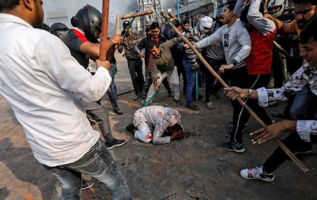SENSITIVE MATERIAL. THIS IMAGE MAY OFFEND OR DISTURB  A group of men chanting pro-Hindu slogans, beat Mohammad Zubair, 37, who is Muslim, during protests sparked by a new citizenship law in New Delhi, India, February 24, 2020. REUTERS/Danish Siddiqui/File photo