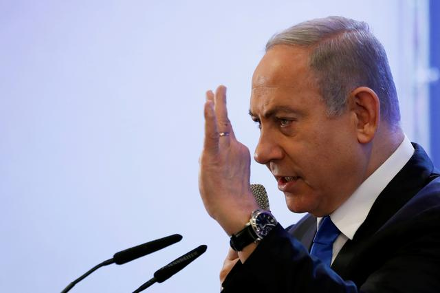 Israeli Prime Minister Benjamin Netanyahu gestures as he speaks at a regional council chairpersons' conference in Kiryat Anavim, Israel February 26, 2020. REUTERS/Ronen Zvulun
