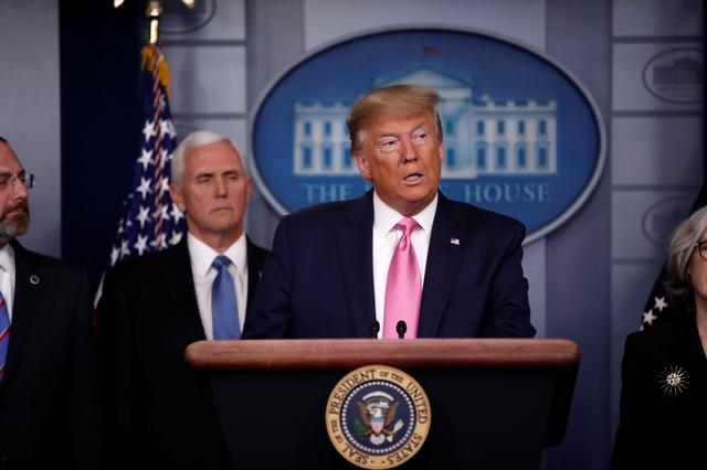 U.S. President Donald Trump stands with Vice President Mike Pence and members of his coronavirus task force during a news conference at the White House in Washington, U.S., February 26, 2020.  REUTERS/Carlos Barria