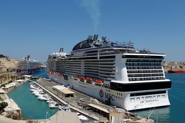 FILE PHOTO: The cruise liners MSC Meraviglia and Mein Schiff 5 (rear) are seen berthed in Valletta's Grand Harbour, Malta, August 2, 2017.   REUTERS/Darrin Zammit Lupi/File Photo