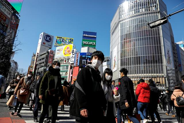 FILE PHOTO: People wearing protective masks are seen in the Shibuya shopping district in Tokyo, Japan, February 24, 2020. REUTERS/Athit Perawongmetha