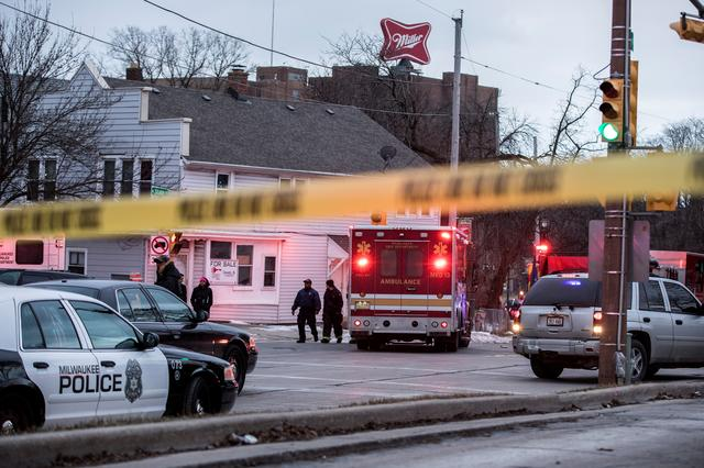 FILE PHOTO: Police investigate a shooting at the Molson Coors headquarters in Milwaukee, Wisconsin, U.S. February 26, 2020.  REUTERS/Sara Stathas
