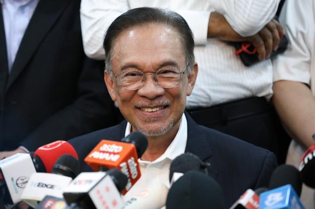 FILE PHOTO: Malaysian politician Anwar Ibrahim smiles during a news conference in Petaling Jaya, Malaysia, February 26, 2020. REUTERS/Lim Huey Teng