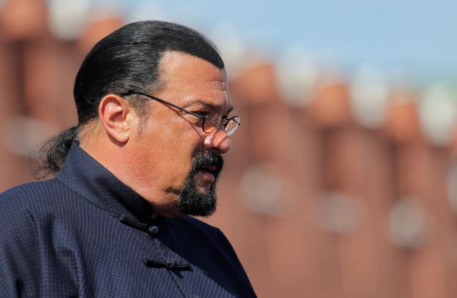 FILE PHOTO: U.S. actor Steven Seagal watches the Victory Day parade, marking the 73rd anniversary of the victory over Nazi Germany in World War Two, at Red Square in Moscow, Russia May 9, 2018. REUTERS/Maxim Shemetov