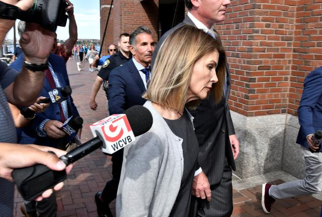 FILE PHOTO: Actress Lori Loughlin, and her husband, fashion designer Mossimo Giannulli leave the federal courthouse after a hearing on charges in a nationwide college admissions cheating scheme in Boston, Massachusetts, U.S., August 27, 2019.  REUTERS/Josh Reynolds