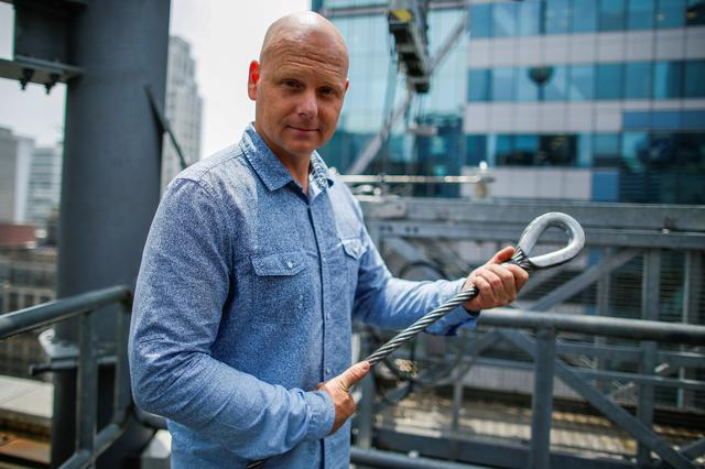 FILE PHOTO: Aerialist Nik Wallenda holds a sample of a wire while he speaks with media as he prepares for a highwire walk over Times Square in New York, U.S., June 20, 2019.  REUTERS/Eduardo Munoz/File Photo