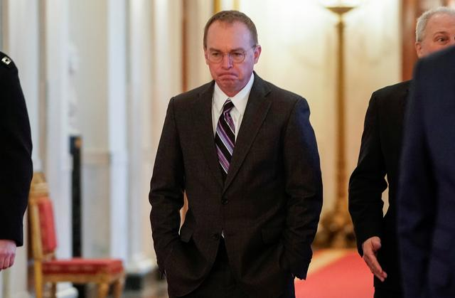 FILE PHOTO - White House Acting Chief of Staff Mick Mulvaney arrives before U.S. President Donald Trump delivers joint remarks with Israel's Prime Minister Benjamin Netanyahu on a proposed Middle East peace plan proposal in the East Room of the White House in Washington, U.S., January 28, 2020. REUTERS/Joshua Roberts