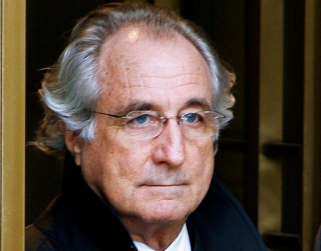 FILE PHOTO: Bernard Madoff exits the Manhattan federal court house in New York on January 14, 2009. REUTERS/Brendan McDermid/File Photo