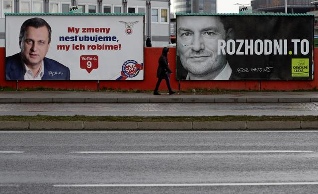 A woman walks past election posters ahead of the country's parliamentary election in Bratislava, Slovakia February 28, 2020. REUTERS/David W Cerny