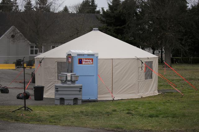 A support operations tent is seen at a earmarked quarantine site for healthy people potentially exposed to novel coronavirus, behind Washington State Public Health Laboratories in Shoreline, north of Seattle, Washington, U.S. February 28, 2020. REUTERS/David Ryder