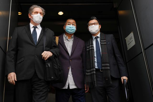 FILE PHOTO: Media mogul and Apple Daily founder Jimmy Lai Chee-ying (C) leaves from a police station after being arrested for illegal assembly during the anti-government protests in Hong Kong, China February 28, 2020. REUTERS/Tyrone Siu