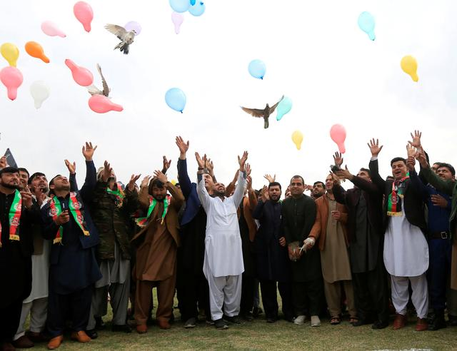 Afghan men celebrate in anticipation of the U.S-Taliban agreement to allow a U.S. troop reduction and a permanent ceasefire, in Jalalabad, Afghanistan February 28, 2020.   REUTERS/Parwiz