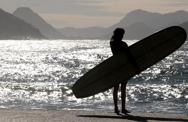 FILE PHOTO: A surfer is seen at Copacabana beach in Rio de Janeiro, Brazil July 19, 2019. REUTERS/Sergio Moraes/File Photo