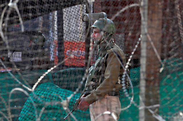 FILE PHOTO: An Indian policeman stands guard outside a bunker alongside a road in Srinagar October 31, 2019. REUTERS/Danish Ismail