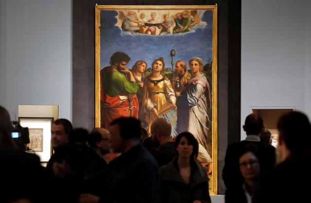 "Members of media pass by painting titled ""The Ecstasy of Saint Cecilia"" by Renaissance master Raphael during the unveiling of a blockbuster exhibition commemorating the 500th anniversary of his death, at the Scuderie del Quirinale in Rome, Italy, March 4 2020. REUTERS/Remo Casilli"