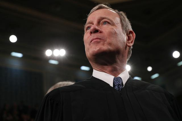 FILE PHOTO: U.S. Supreme Court Chief Justice John Roberts waits for U.S. President Donald Trump's State of the Union address to a joint session of the U.S. Congress in the House Chamber of the U.S. Capitol in Washington, U.S. February 4, 2020. REUTERS/Leah Millis/POOL/File Photo