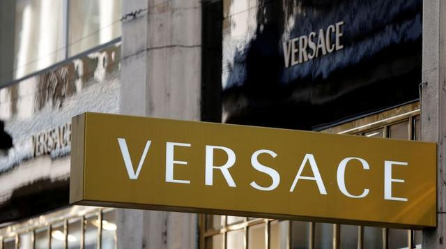 FILE PHOTO: Company logos are pictured outside a Versace store in Vienna, Austria, April 21, 2016.  REUTERS/Leonhard Foeger