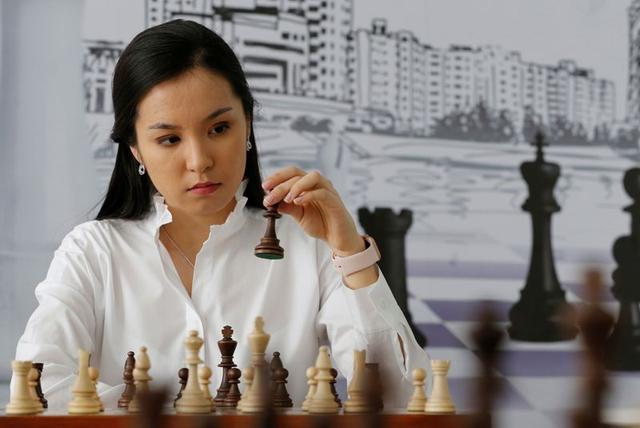 Dinara Saduakassova, a 23-year-old Kazakh chess player and social activist, poses for a picture in the Chess Academy she founded in Nur-Sultan, Kazakhstan March 3, 2020. Saduakassova has opened a chain of chess schools in the country and has become a Goodwill Ambassador of the UNICEF. REUTERS/Pavel Mikheyev