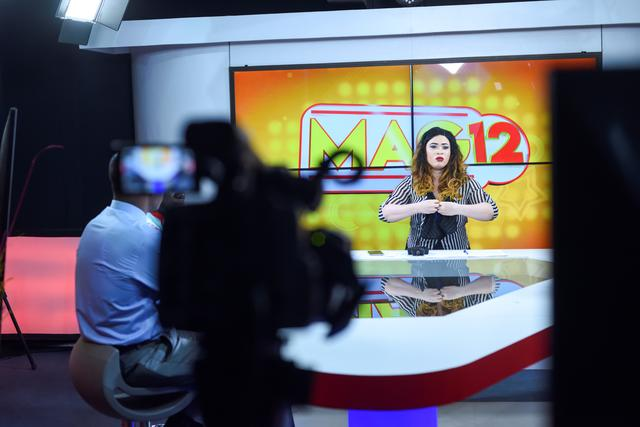 Line Banty, an albino presenter of the Mag 12 show on 3TV channel, is seen during her live show on the screen of the control room of the private TV station in Ouagadougou, Burkina Faso February 28, 2020. Picture taken February 28, 2020. REUTERS/Anne Mimault