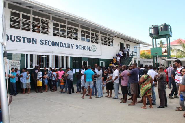 FILE PHOTO: People queue to vote in Guyana's presidential elections in Georgetown, Guyana March 2, 2020. REUTERS/Neil Marks