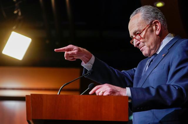 FILE PHOTO: U.S. Senate Minority Leader Chuck Schumer (D-NY) takes questions as he speaks to reporters after the Senate voted to acquit U.S. President Donald Trump of both charges in his Senate impeachment trial on Capitol Hill in Washington, U.S., February 5, 2020.  REUTERS/Joshua Roberts