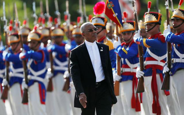 FILE PHOTO: Guyana's President David Arthur Granger review an honour guard during Mercosur trade bloc annual summit in Brasilia, Brazil December, 21, 2017. REUTERS/Adriano Machado