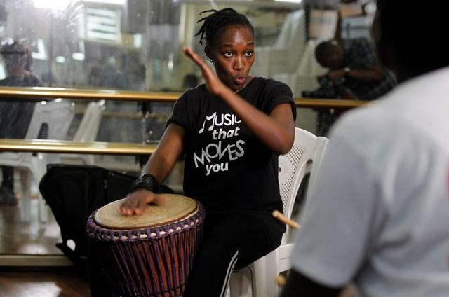 FILE PHOTO: Percussionist Kavisa Mutua and the founder of an all female percussionist group, Motra, attends a training session at the Kenya National Theatre in Nairobi, Kenya February 25, 2020.  REUTERS/Njeri Mwangi