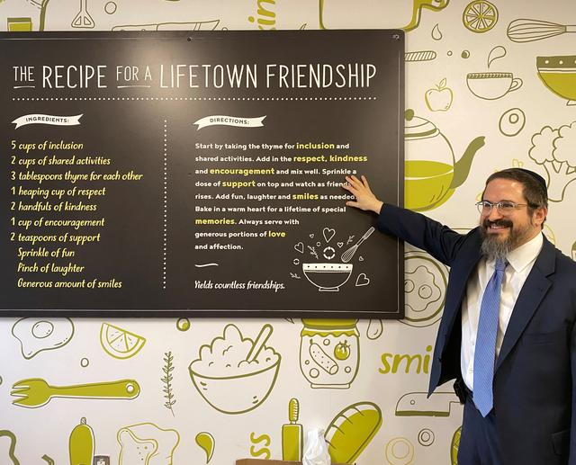 Co-founder and CEO of LifeTown Rabbi Zalman Grossbaum reacts in front of a sign displayed in a kitchen in LifeTown, a 53,000-square-foot center dedicated to teaching life skills to children and adults with special needs, in Livingston, New Jersey, U.S. March 2, 2020. REUTERS/Roselle Chen