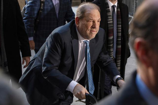 FILE PHOTO: Harvey Weinstein arrives at New York Criminal Court for another day of jury deliberations in his sexual assault trial in the Manhattan borough of New York City, New York, U.S., February 24, 2020.  REUTERS/Lucas Jackson/File Photo