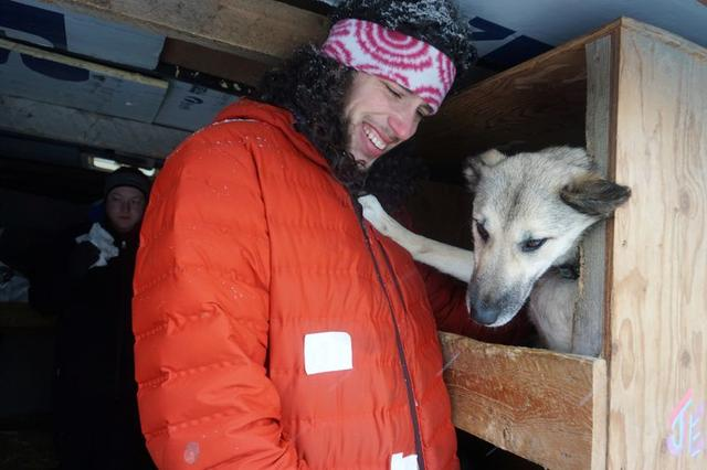 Musher Sean Underwood, a dog handler who became a last-minute substitute for four-time champion Jeff King after the latter had emergency surgery, greets the team inside King's dog truck in downtown Anchorage at the start of the 2020 Iditarod Trail Sled Dog Race, Alaska, U.S. March 7, 2020. REUTERS/Yereth Rosen